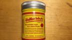 Eine gelbe Dose der Marke Halloo Wach
