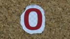 Eine rote Null auf einer Pinnwand
