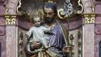 Der heilige Joseph mit dem Jesuskind auf dem Arm