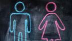Auf einer Tafel ist in Blau eine Mann-Figur und in Rosa eine Frau-Figur gezeichnet.