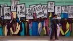 """Bemalte Wand imit dem Wahlspruch """"I am a man""""."""