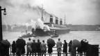 Ob im Westen oder Osten - die Hoffnung auf eine bessere Zukunft treibt die Migrierenden an. Ankunft des Passagierschiffs «Levathian» in New York 1933.