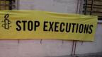 Ein Amnesty-Plakat gegen Todesstrafe.