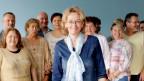 Barbara Metelska, umgeben von mehreren Pflegern und Pflegerinnen.