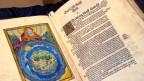 Cranachbibel mit Darstellung der religiösen Schöpfungungsgeschichte.