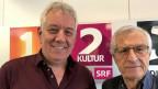 Zwei Herren vor einem Banner von SRF 2 Kultur