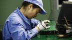 Eine Chinesin bei der Arbeit