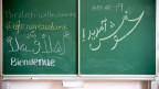 """Wandtafel mit der Aufschrift """"Herzlich willkommen"""" in verschiedenen Sprachen"""