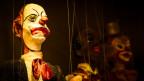 Marionette mit Clowngesicht