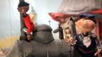 Szene aus Puppentheater: Jim Knopf mit Lukas in der Lokomotive