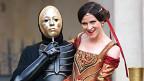 Links schwarz gekleideter Schauspieler mit goldener Maske, rechts lächelnde Schauspielerin in butem Kostüm