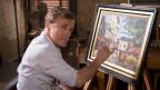 Christoph Waltz zeichnet ein Gemälde.