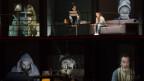 Bühnenbild zeigt sechs Elemente, in denen Menschen wie an Fenstern sitzen