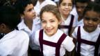 Kinder aus Kuba lachen in die Kammera.