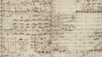 Zu sehen sind originale Abschriften der Matthäus-Passion von Johann Sebastian Bach.