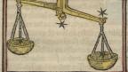 Eine Waage, ein Sternzeichen, ist abgebildet.