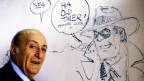 Porträt von Will Eisner, im Hintergund eine Comicfigur von ihm.