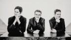 Ein Schwarz-Weiss-Bild von drei Männern mittleren Alters.