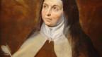 Eine Nonne blickt gegen den Himmel