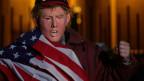 Ein Mann mit Trump-Maske bei einer Demo gegen den Klimawandel.
