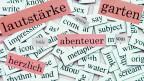 Wörter (Kühlschrank-Magnete) unterschiedlicher Sprachen