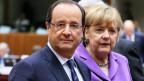 Der französische Präsident Francois Hollande (links) die deutsche Bundeskanzlerin Angela Merkel am EU-Gipfel in Brüssel, Belgien, am 25. Oktober 2013.