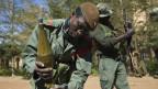 Ein Soldat der malischen Regierungstruppe während Kämpfen mit Islamisten in Gao.