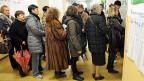 Wählerinnen und Wähler in ganz Italien gehen an die Urnen, hier in Mailand.