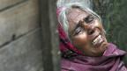 Die Mutter des mutmasslichen Vergewaltigers, der im indischen Dehli im Gefängnis ums Leben gekommen ist. Die Eltern sind der Meinung, dass ihr Sohn ermordet wurde.