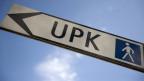 Strassenschild zur Uni-Psychiatrie (UPK) in Basel.