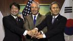 Der US-Verteidigungsminister Chuck Hagel mit seinen Amtskollegen aus Südkorea und Japan.