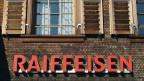Nicht nur Raiffeisen müht sich ab mit FATCA. Praktisch keine Schweizer Bank kann die Forderungen der Amerikaner ignorieren.  Logo der Raiffeisen-Bank in Köniz.
