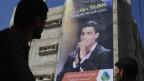 Der Sänger Mohammed Khan Younis in Assaf auf einem Plakat im südlichen Gazastreifen, 20. Juni 2013. Er ist einer der Finalisten beim TV-Talentwettbewerb «Arab Idol».