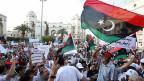 Volksproteste gegen die anhaltende Militärpräsenz auf den Strassen der libyschen Hauptstadt Tripoli, am 7. Juli 2013.