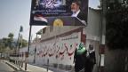Palästinenserinnen am 9. Juli im nördlichen Gazastreifen, vor dem Plakat des abgesetzten ägyptischen Präsidenten Mursi.