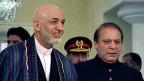 Der afghanische Präsident Hamid Karzai und der neue pakistanische Premier Nawaz Sharif, am 26. August in Islamabad.