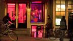 Sexarbeiterinnen im Rotlichtbezirk von Amsterdam.