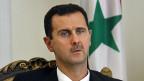Der syrische Präsident Bashar al-Assad anlässlich eines Treffens mit dem iranischen Präsidenten Ahmadinejad, am 19. August 2013.