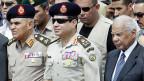 Der ägyptische Armeechef General al-Sisi (mitte) und der interimistische Premier el-Beblawi.