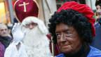 In den Niederlanden begleitet der «Zwarte Piet», der schwarze Peter, den Nikolaus.