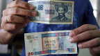 Zwei unterschiedliche 20-Peso-Noten: Oben in Peso cubano und unten in Peso convertible.