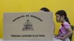 Wahlkabine in einem Wahllokal in Tegucigalpa, Honduras, am 24. November 2013. Die Honduraner wählen einen neuen Präsidenten.