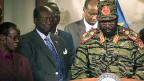 Am 16. Dezember ist Südsudans Präsident Salva Kiir nicht mehr wie üblich im Anzug und mit schwarzem Hut aufgetreten, sondern in Uniform - als Soldat und Kämpfer.
