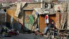 Ein Slum für WanderarbeiterInnen am Rande Pekings.