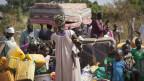 Flüchtlinge aus Südsudan kommen in Uganda an