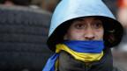 Ein Anti-Regierungs-Demonstrant auf dem Unabhängigkeitsplatz in Kiew am 21. Februar 2014.