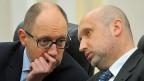Der ukrainische Übergangs-Premier Arseni Jazenjuk und Präsident Alexander Turtschinow scheinen ratlos.