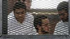 Vier von 20 des Terrorismus angeklagte muslimische Journalisten mussten sich am 24. März 2014 vor Gericht verantworten.