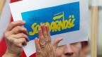 In Warschau zeigen sich auch Solidarnosc-Mitglieder solidarisch mit der ukrainischen Bevölkerung.