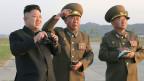 Profitiert das nordkoreanische Regime von der Schulung? Bild: Machthaber Kim Jong Un (links).